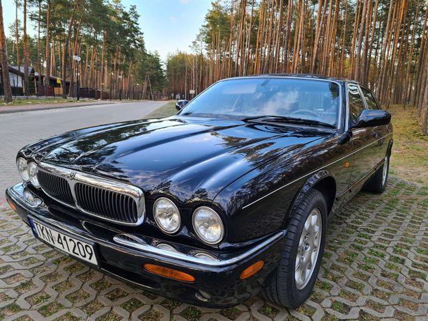 Wynajem auta do ślubu czarny Jaguar XJ klasyk