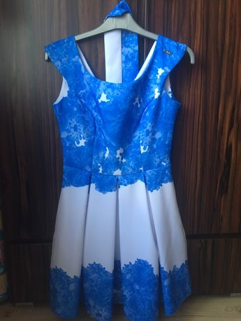 Wiązana elegancka sukienka damska