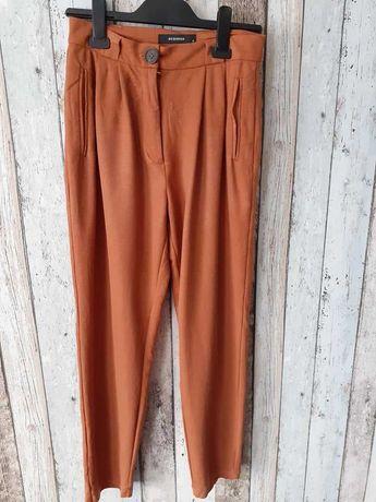 Eleganckie ceglaste spodnie Reserved