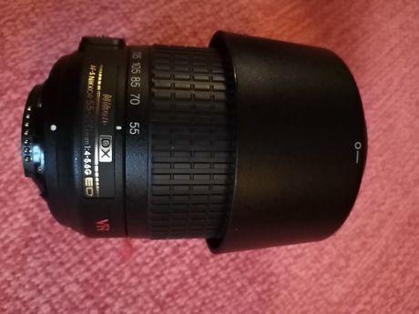 Objetiva Nikon AF-S NIKKOR 55-200mm 1:4-5.6G ED VR + Para-Sol HB-37