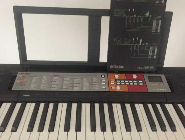 Orgao Yamaha PSR-FS 50 com tripe