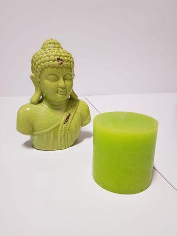 Buda e vela decorativos