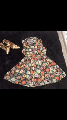 Kwiecista tunika elegancka kwiaty bluzeczka