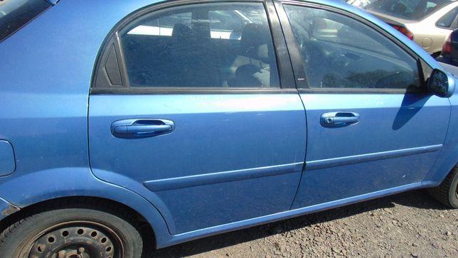 Kwi#Chevrolet Lacetti drzwi tylne prawe 31U