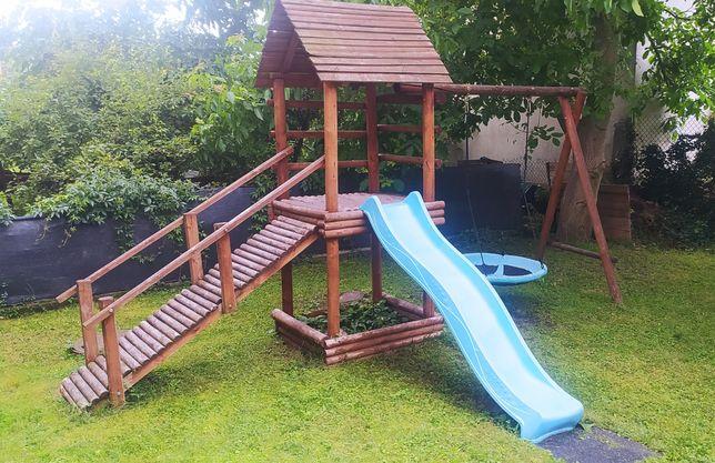Drewniany plac zabaw (domek / wieżyczka, ślizg, bocianie gniazdo)