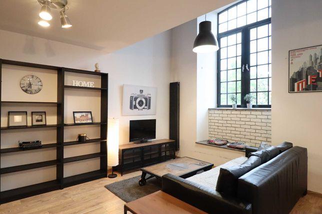 Piętrowy loft z dwoma łazienkami | 90 m2