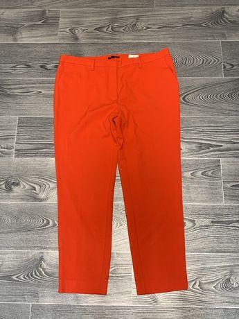 Зауженные красные брюки .