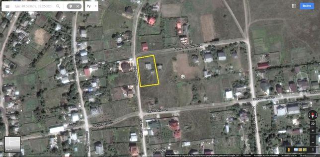 Продам земельный участок с постройками