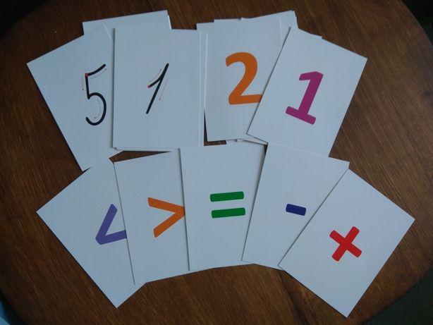Набір цифр, знаків та зразків каліграфічного письма цифр.