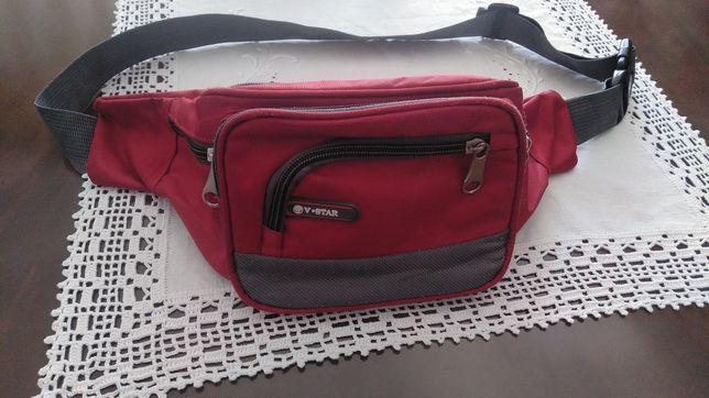 Bolsa de cintura+sacos de viagem+raquetes+flautas.