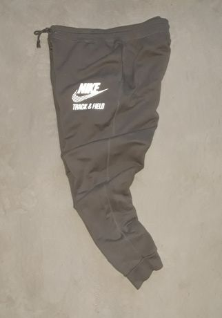 Nike Track & Field spodnie joggers męskie odblaski r. XL jak nowe