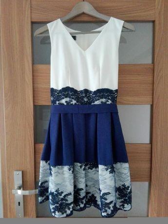 Rozkloszowana elegancka sukienka koronka chrzest wesele
