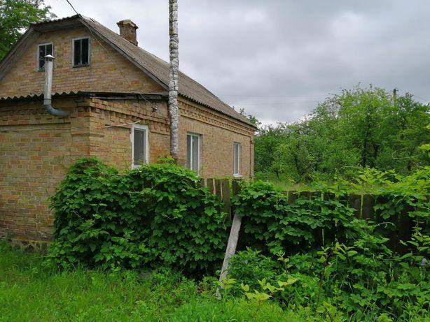 Продам будинок, дерев'яний обкладений цеглою