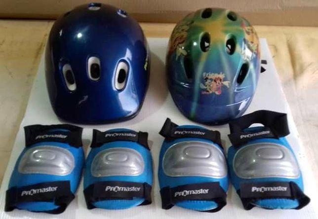 Dois capacetes e dois pares de joelheiras como novos.