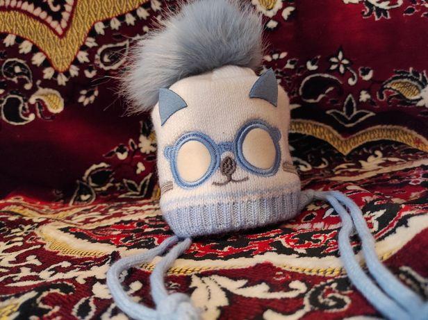 Детская зимняя шапочка на завязках