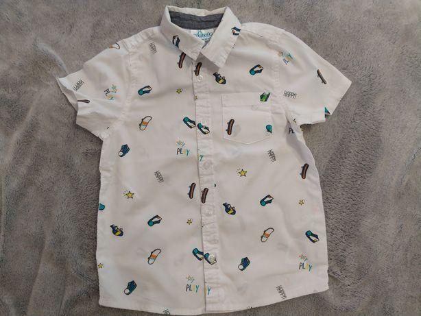 Sprzedam białą koszulę elegancka chłopiec deskorolki