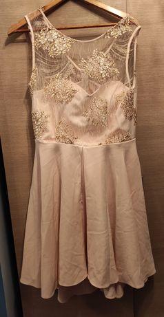 Pastelowa sukienka rozmiar 46