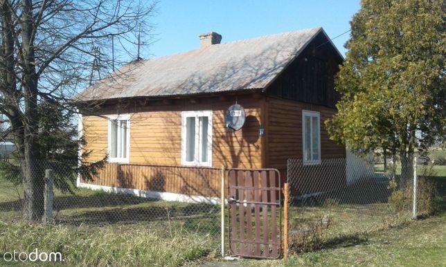 Sprzedam działkę 0,71 ha z domem drewnianym