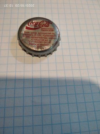Крышка - Coca-Cola.