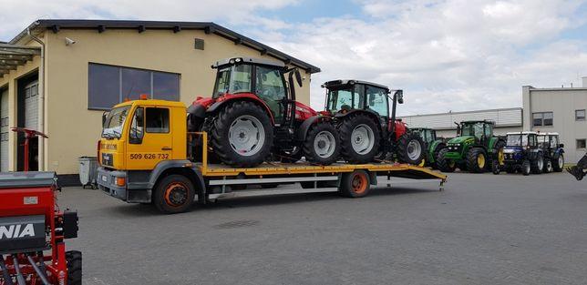 Transport ciągników koparki pomoc drogowa laweta