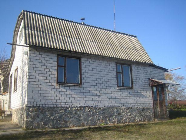 Будинок над самим Дніпром у Каневі із земельною ділянкою 10 соток