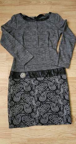 Плаття жіноче , розмір 42 в гарному стані без деіектів