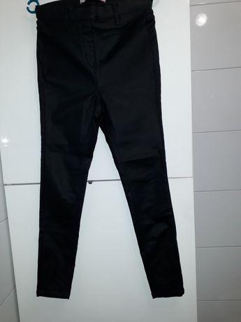 Nowe bez metki uciagliwe czarne spodnie rozmiar 38