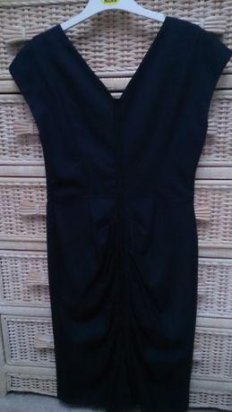 Sukienka firmy Aryton w rozmiarze 38.