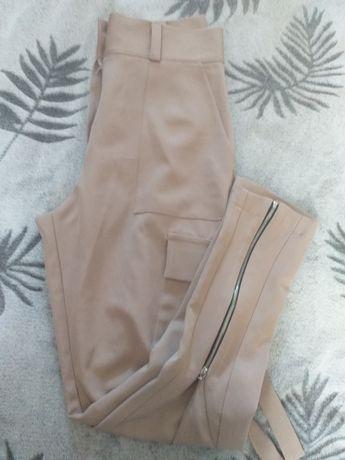Eleganckie spodnie z zamkami