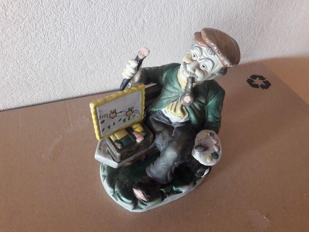 Figurka malarz na ławce