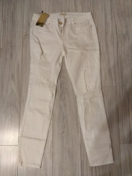 Spodnie z przetarciami r. 40