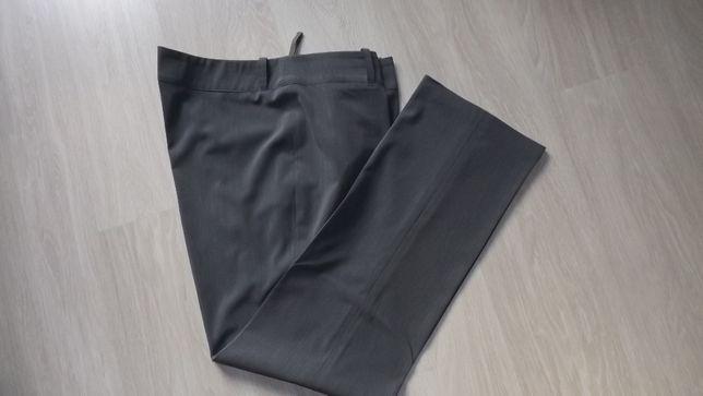 Eleganckie spodnie na kant dla wysokiej roz.48