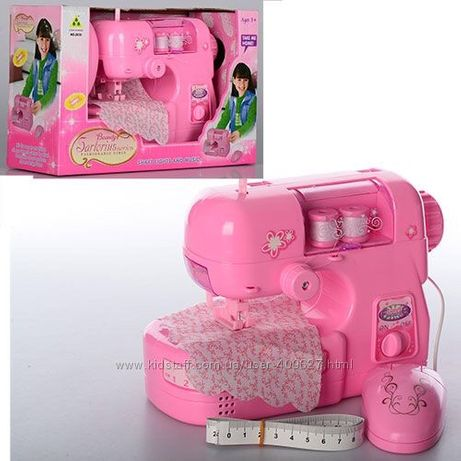 Детская швейная машина, шьет, с педалью.