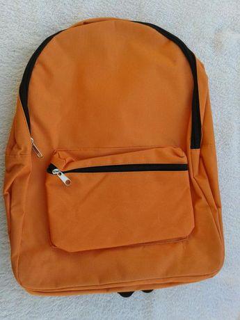 Mochila laranja. Nova escola