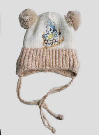Теплая шапочка на малыша