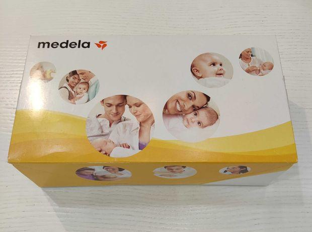 Молокоотсос Medela (медела), механический, набор бутылочек в подарок