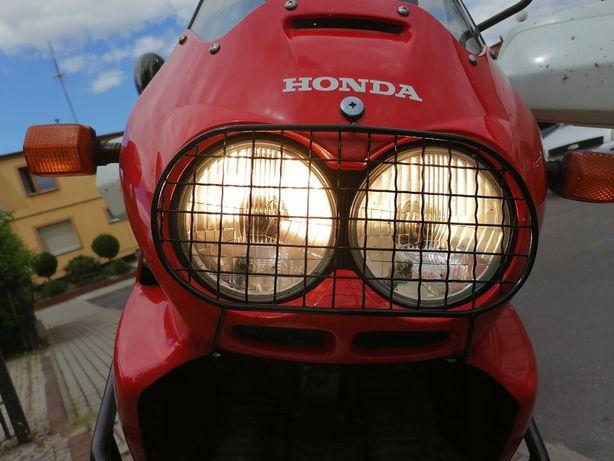 Sprzedam osłonę lampy przedniej do HONDA AFRICA TWIN 750 RD 07A