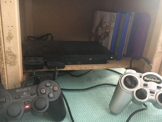 Playstation 2 Slim + 2 comandos e jogos