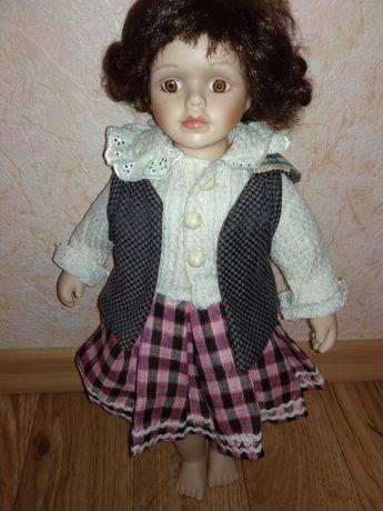 Продам фарфоровую куклу