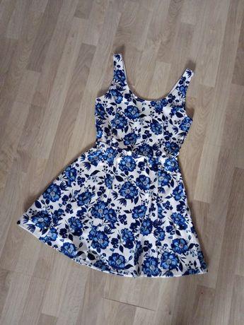 Rozkloszowana sukienka na ramiączkach biała granatowa kwiaty H&M 40 L