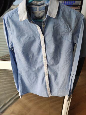 Błękitna koszula z łatami marki medicine