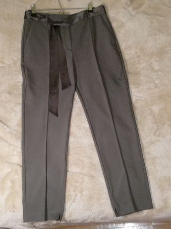 Eleganckie spodnie Orsay w kolorze khaki z szarfą rozm. 40 jak nowe