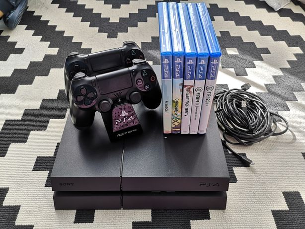 PS4 1TB com jogos físicos e digitais