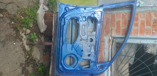 водительскую дверь Chevrolet Aveo