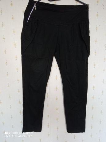 Czarne spodnie damskie z zamkami