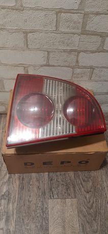 Продам фонарь задній для Volkswagen Passat B5 00-05 левий