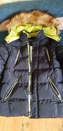 Продам зимову куртку на хлопчика 9-10років  гарної якості, в ідеальном