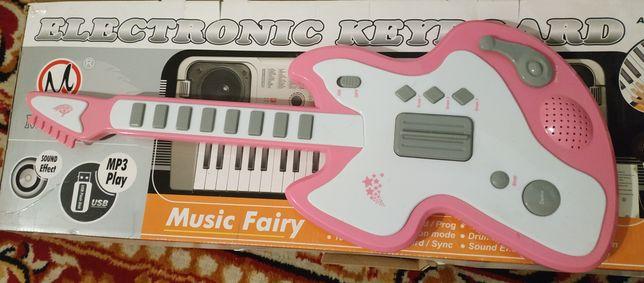 Gitara - instrument zabawka.
