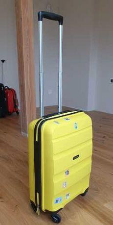 Walizka American Tourister żółta dla dzieci na 4 kółkach