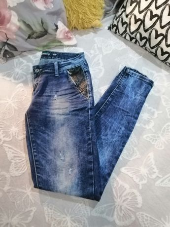 Spodnie rurki  rozmiar 38-42